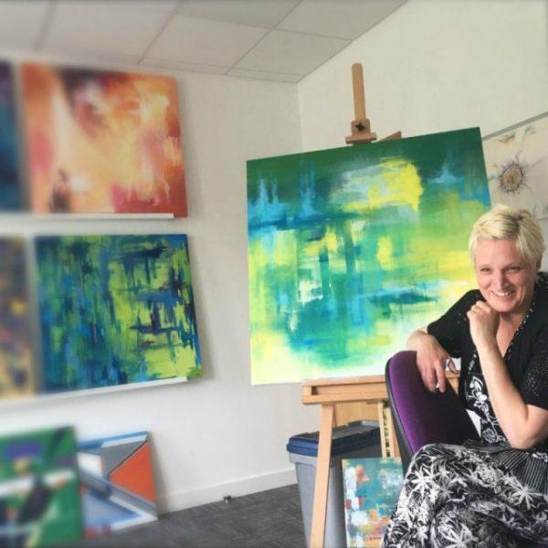 Artist Kerry Sage with artwork